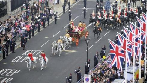 The Duke and Duchess of Cambridge travel in the 1902 State Landau carriage along the Processional Route to Buckingham Palace, 29 April 2011.